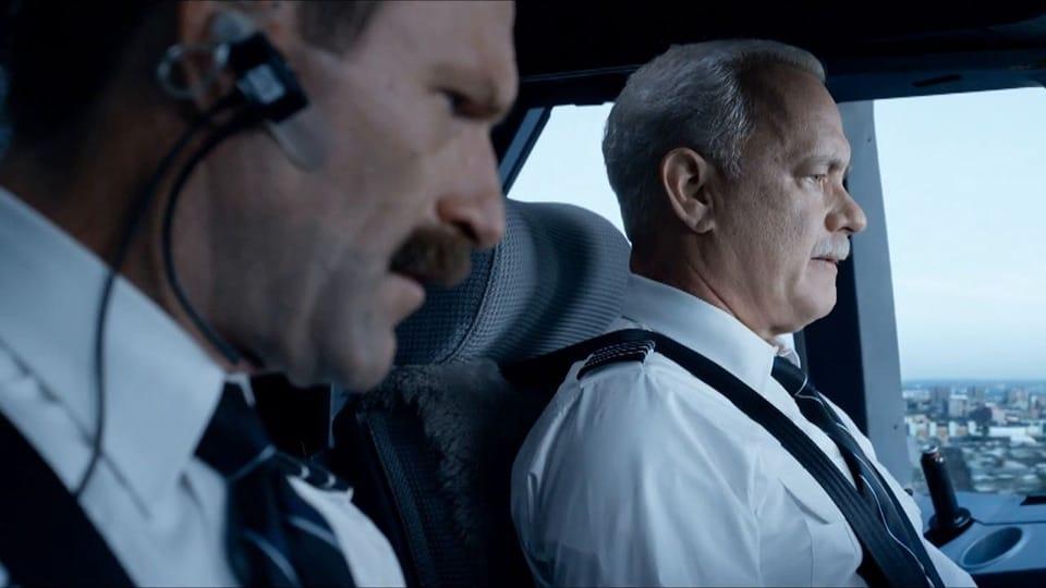 Aaron Eckhart y Tom Hanks